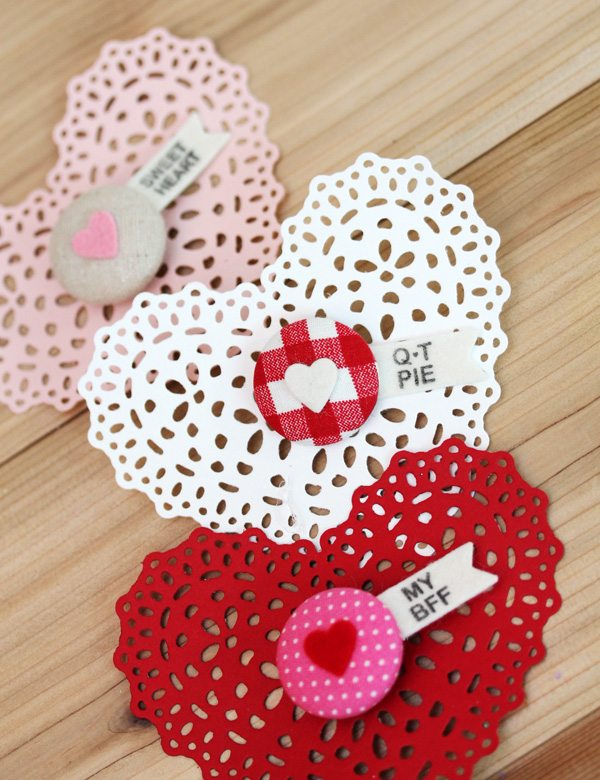 Trio of heart doilies with button pins
